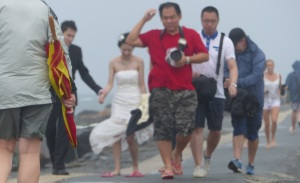 Sorry. Out of focus wedding on the breakwater in driving wind and rain.