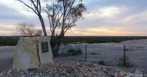 """The beginning of sunset from the original """"ridge"""" site of the first shaft sunk in 1902 and from where the first miner, Charles Waterhouse Nettleton sold his first black opal in 1903."""