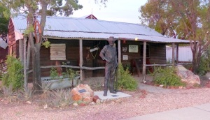 An old original miners hut now a historical society museum. The statue is of Charles Waterhouse Nettleton.