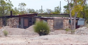 Anothyer miners house in the lonely original ridge. Note much of the house is constructed from local rock and the roof is various types of roofing material held down by more rocks.