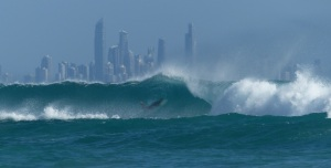 great surf at Kirra Beach framing the skyline of Surfers Paradise in the background.