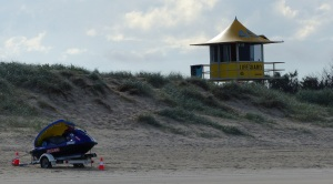 Lifeguard station and rescue jet ski on the beach at the north end of The Spit.