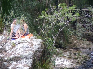 This couple are sitting on a rock precariously above a sheer drop beside Double Falls.