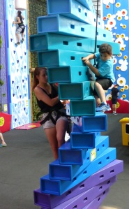 Shelby on one of the climbing walls.