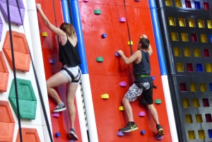 Shelby and Anakin on a rock wall race.