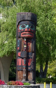 Cedarman Holding a Talking Stick Totem. It is the largest pole in circumference in the world.