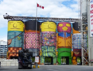 Beside the popular and colourful Granville Island is a cement works which is unnattracrive. The works have been painted to blend in with its surroundings.