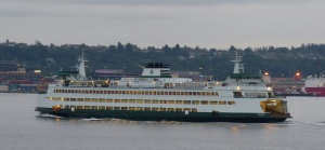 In the dim overcast early morning light I can see many of these Washington State Ferries with cheerful lights moving about the harbour.