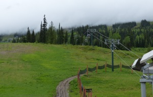 The empty gondola on the hill above the resort shrouded in cloud.