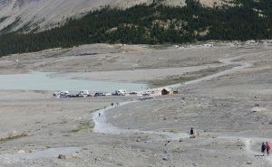 Carpark at the base of t Moraine created by the receding Athabasca Glacier. Way in the background can be seen the carpark for the Icefields Discovery Centre.
