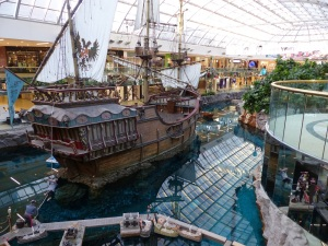 A pirate ship on an lake inside the mall. the water is so clear it looks almost empty. Each tile on the bottom is seen clearly. I understand that until recently dolphins swam in the lake.