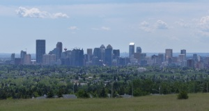 City of Calgary rising out of the plains as seen  from the vast Nosehill Park.
