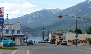 View of Kaslo with single traffic light which is always flashing amber.