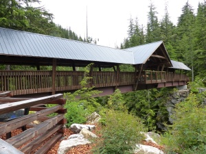 Covered Timber footbridge over Kuskanax Creek near Nakusp Mineral Springs.