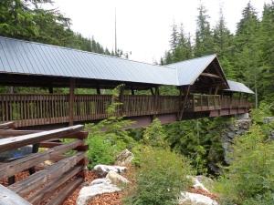 Covered Timber footbridge over Kuskanax Creek near Nakusp Mineral Springs.