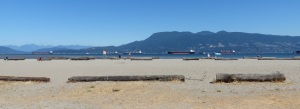 Locarno Beach. Note the logs spread out across the beach and the container ships in the bay.
