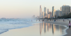 Surfers Paradise reflected in the wet sands.
