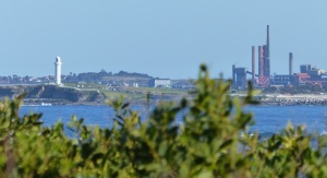 Wollongong seen from Bellambi Lagoon. On the far left is the lighthouse on Flagstaff Hill overlooking Wollongong Harbour. The chimneys in the middle are part of the steelworks at Port Kembla.