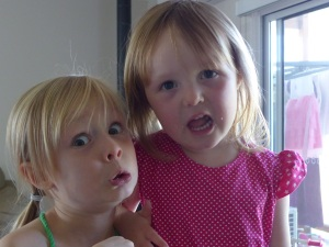 Amelia and Hannah practise pulling faces.