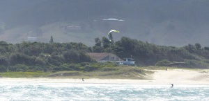 Wind surfers doing what they do.