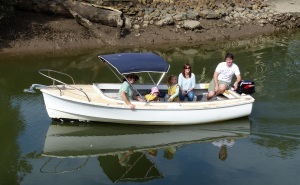 Errol Hannah Amelia and Nicole in Steves boat on Biggera Creek below our village.