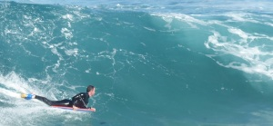 Boogey Board rider takes on a two metre surf break at Bronte.