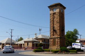 The iconic middle of town Clock Tower with the sandstone court house and Police station in the background.