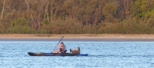 It looks like this is a well equipped, self sufficient fisherman on his paddle ski.