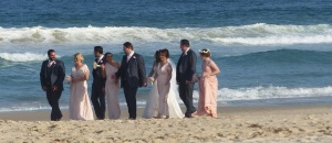 A wedding party on a posed stroll.
