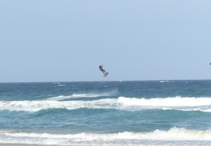 Airborne! One of the joys of kite surfing in a howling southerly gale.