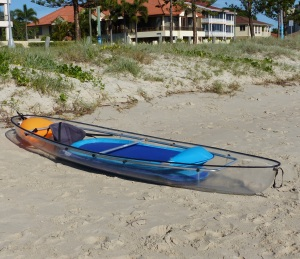 Glass canoe on the beach at Biggera Waters, The Broadwater.