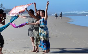 Happy Asians enjoying the wind at the beach.