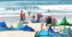 Part of the large crowd of kite surfing enthusiasts.