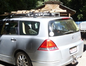 Interesting car with Bamboo roof racks and a bent steel tow bar.