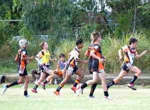 Chris team the Easts Leagues Tigers Under 12, chasing and supporting their own player.