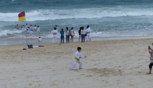 This group of a Brisbane based Japanese family karate group took a plunge in the ocean in full kit as part of their training. Note the young man still testing his skills while his mates soak up the surf.