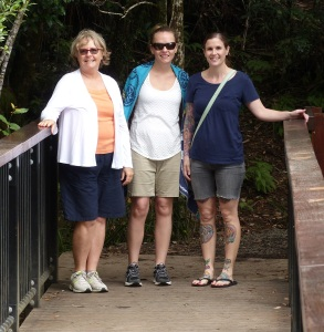 On one of many bridges over water courses which rush to fall over the escarpment lip. Donnis Alecia and Sarah.