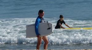 Frank leaves the water with his Boogey Board.