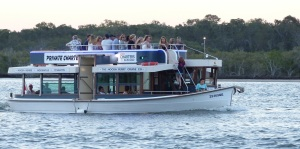 One of several tourist boats on the Noosa River day and night.