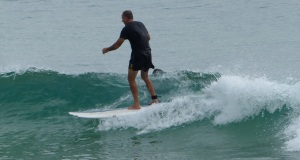 Standup Paddle Board Rider on a gentle Noosa Headland surf break.