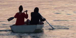 These girls are totally uncoordinated trying to paddle to friends waiting on a yacht in Frenchmans Bay.