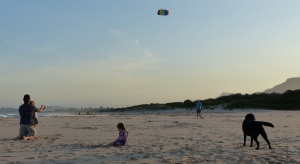 Errol and Amelia flying a kite.