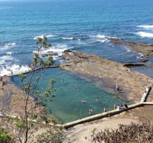 The original Men's Pool between North Wollongong Beach and Belmore Basin. The water is replaced at least twice a day by incoming tides and wave action. Excess water is drained via an overflow valve on the seaward side of the pool. The Women's Pool is located approximately 500 metres away at the base of cliffs below Flagstaff Hill. It could only be accessed by entry through a timber dressing shed and timber staircase. Further around the cliffs via steep steps cut into the cliff are the remains of what was known as The Nuns Pool.