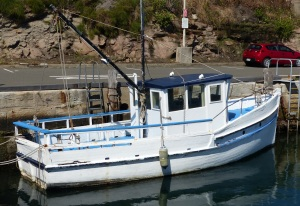 Old and rotting fishing trawler listed for sale.
