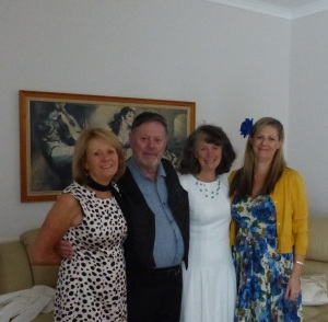 Four fifths siblings. From left, Enid, FrankieG, Bev and Sandra. The painting on the wall are of Flamenco Dancers. This was mum's favourite paintings and now hangs on the wall at Bev's house.