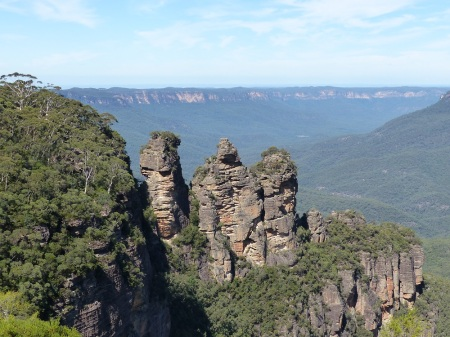 The iconic Three Sisters at Echo Point, Katoomba in the Blue Mountains. Enlarge the photo and look at the first sister on the left. You can see a narrow bridge from the cliffs to the sister.