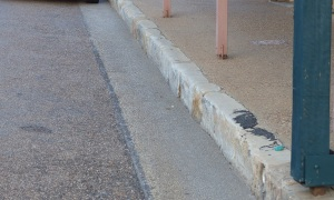Gulgong have left the original rough dressed sandstone on place for the gutters and foothpath edging.