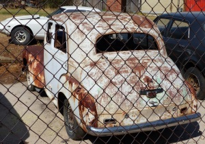 A mechanic shop/panel beater/spray painter at Coolah had a great many old cars dating from around the 1950's. This looks like a Vanguard. Then again it could be another British motor car. Anybody know what it is?