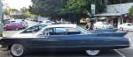 Donnis inspects a Cadillac in the street at Eumundi. Donnis grew up in a family which always had a Caddie.