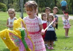 Eloise turned Five today. The party children are lined up to beat the living daylights out of the Butterfly shaped Pinata. The party them was...butterflies.